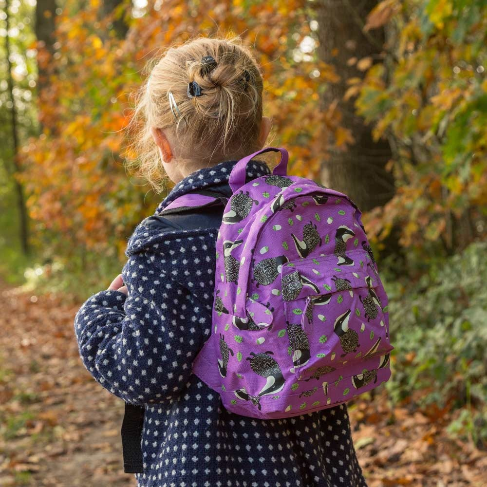 A young girl walking outside