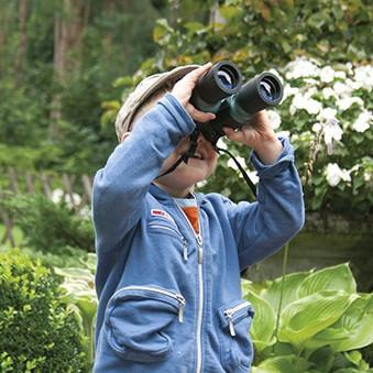 Young boy holding binoculars
